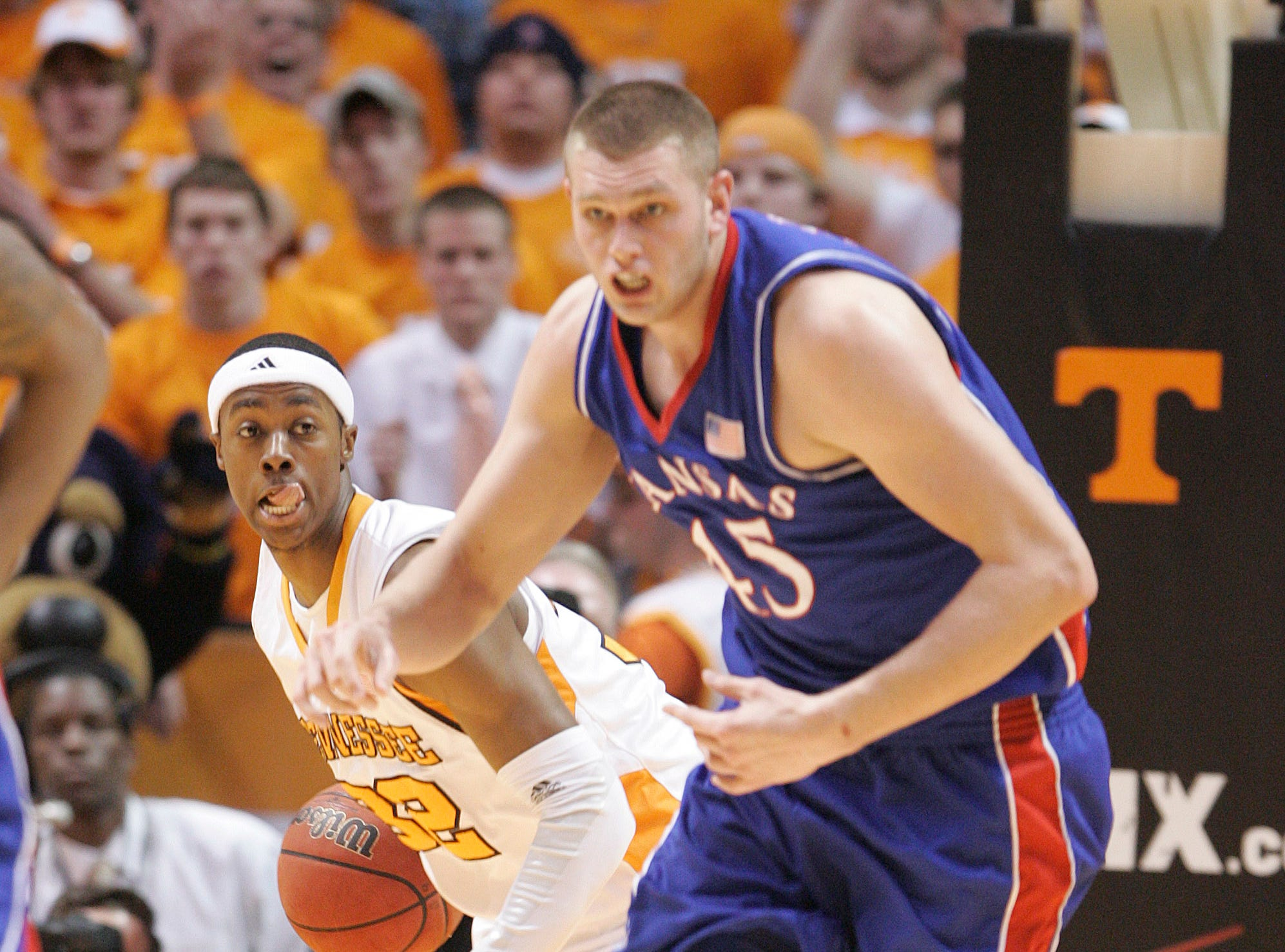 Tennessee's Scotty Hopson (32) rebounds ball against Kansas' Cole Aldrich (45) during the first half of an NCAA college basketball game Sunday, Jan. 10, 2010 in Knoxville, Tenn.