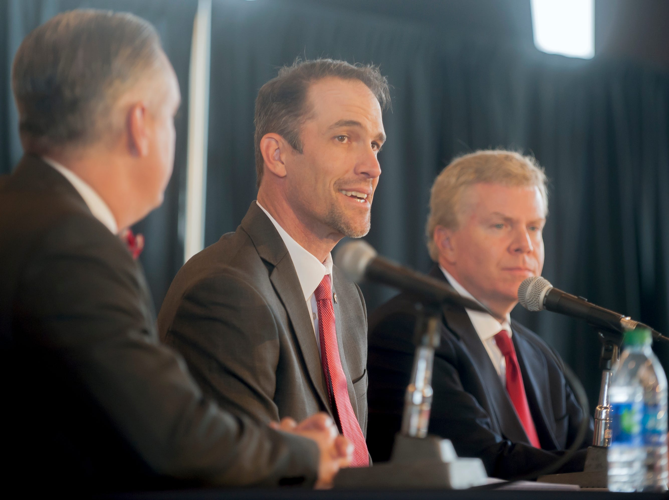 Western Kentucky's new head football coach Tyson Helton, center, speaks as WKU president Tim Caboni, left, and athletic director Todd Stewart, right,  listen during an NCAA college football press conference, Tuesday, Nov. 27, 2018, at the Jack and Jackie Harbaugh Stadium Club at Houchens-Smith Stadium in Bowling Green, Ky.