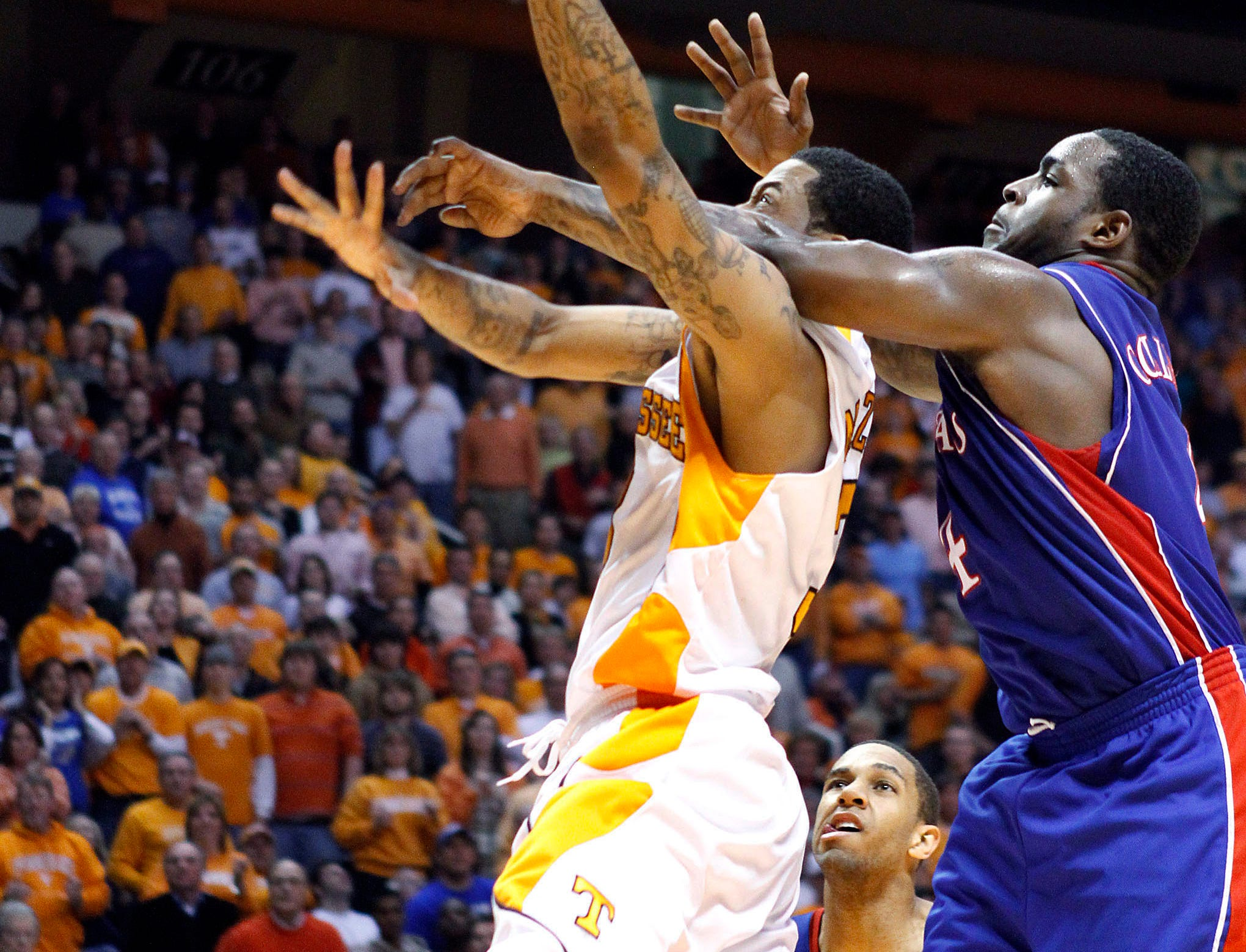 Tennessee's Bobby Maze, left, is fouled by Kansas' Sherron Collins, right, during the second half of an NCAA college basketball game Sunday, Jan. 10, 2010, in Knoxville, Tenn. Tennessee won 76-68.