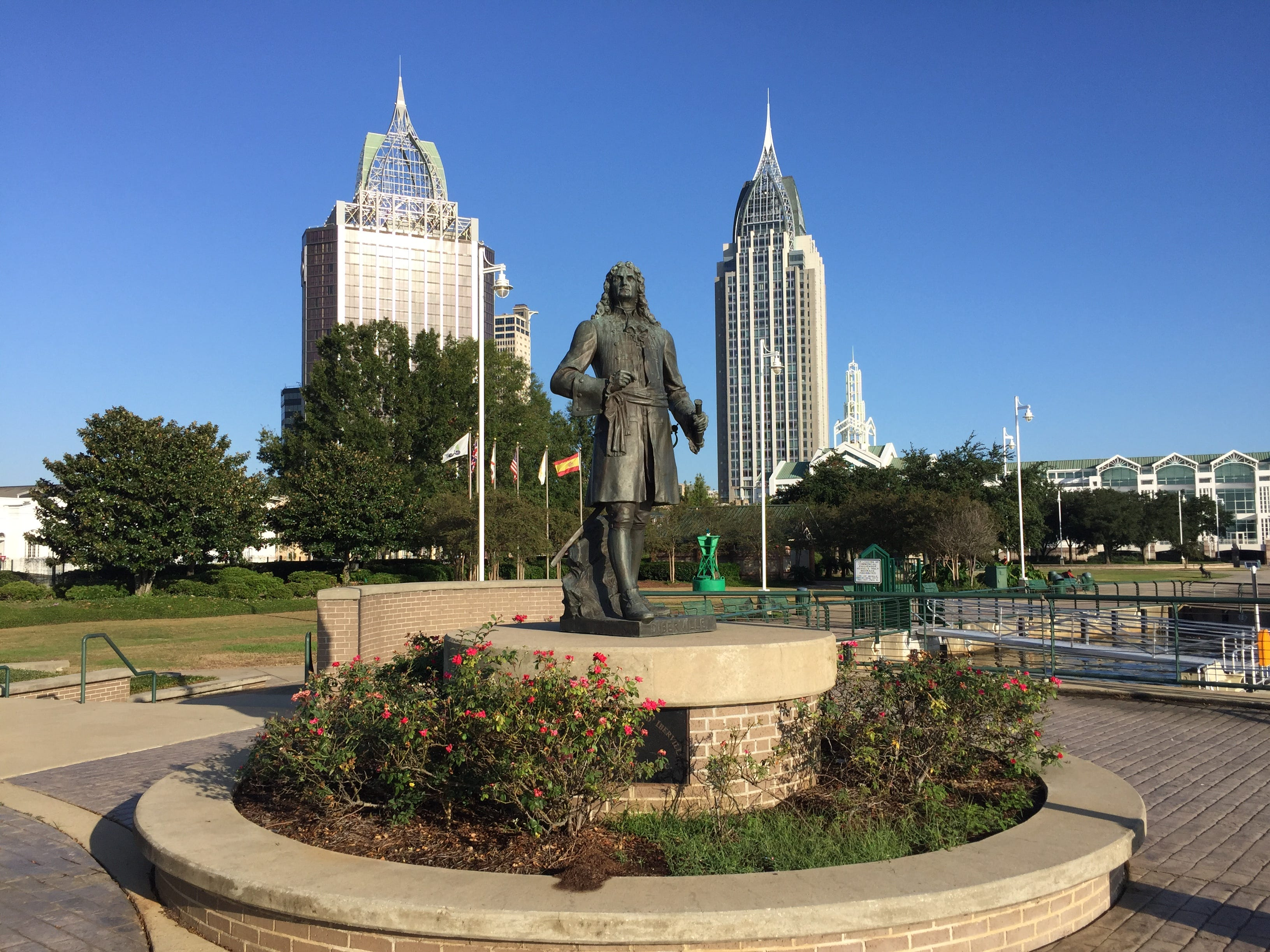 A statue of Mobile founder Jean-Baptiste Le Moyne, Sieur de Bienville, stands in Cooper Riverside Park before two of Alabama's tallest skyscrapers: the RSA Battle House Tower, right, and the Renaissance Riverview Plaza Hotel.