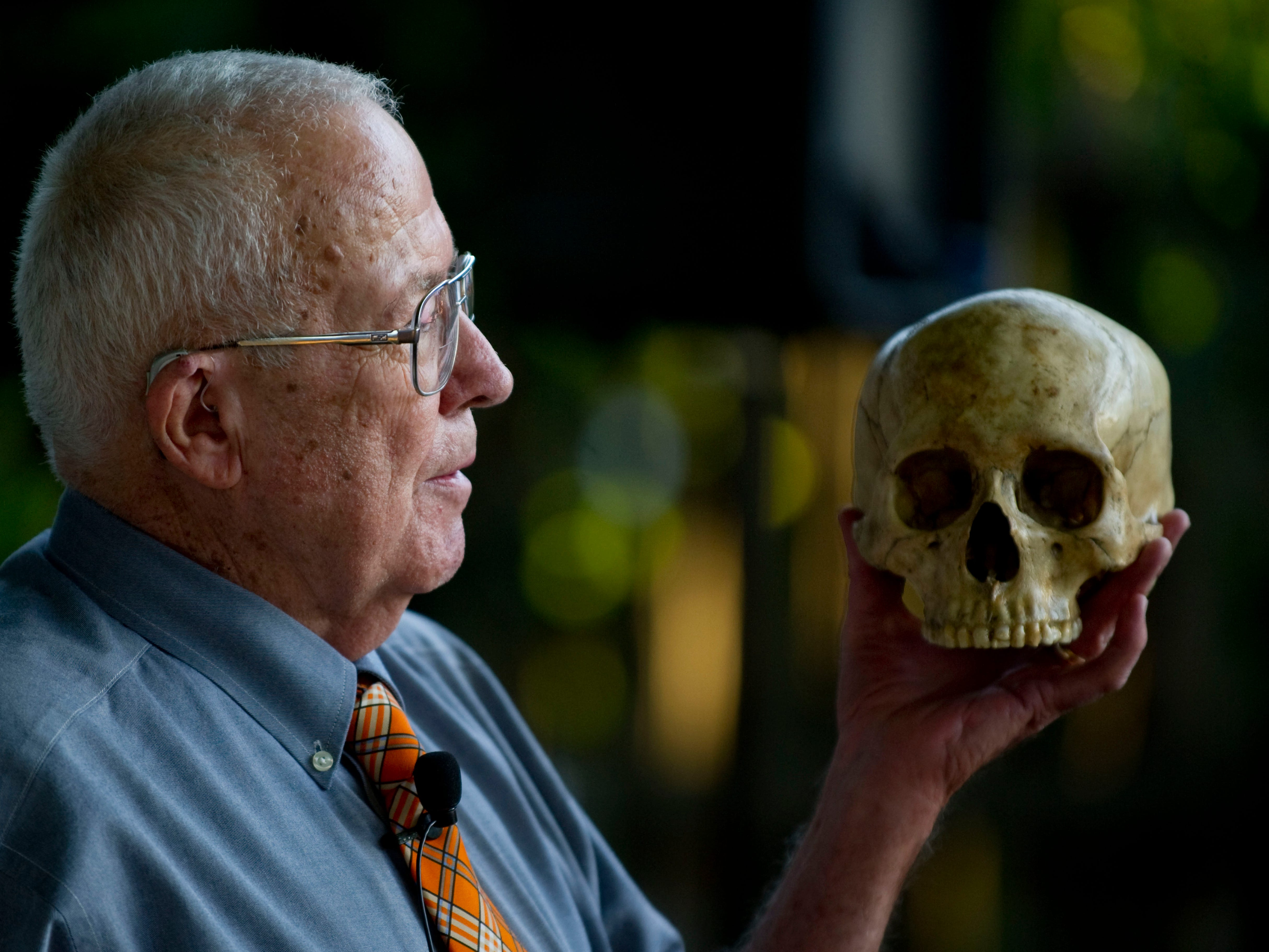Dr. Bill Bass gives a presentation on his forensic work during a fundraiser at James White Fort on Tuesday, June 26, 2012. 