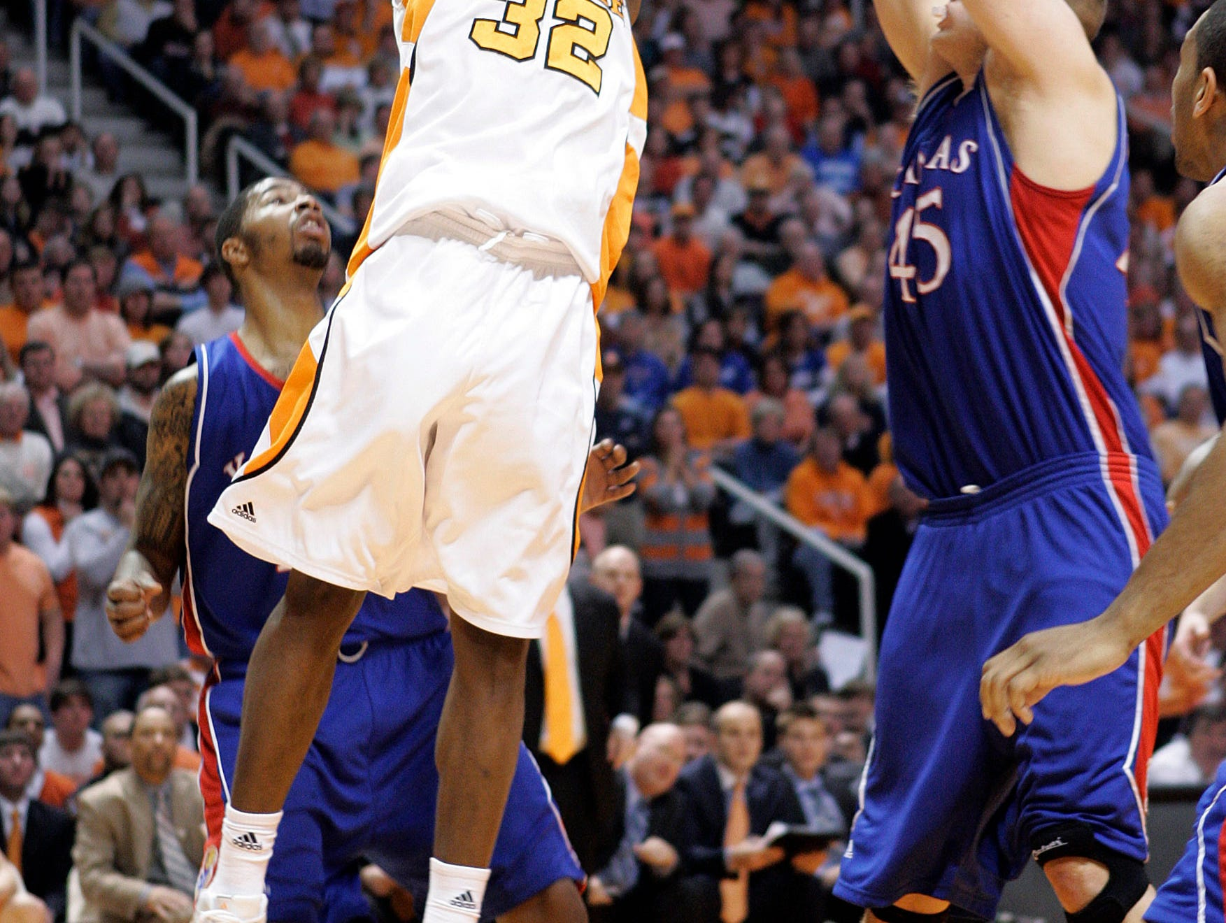 Tennessee's Scotty Hopson (32) drives against Kansas' Cole Aldrich (45) during the second half of an NCAA college basketball game Sunday, Jan. 10, 2010, in Knoxville, Tenn.