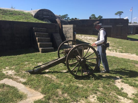 Historical interpreter Robert Bean prepares to shoot a cannon at the Fort Gaines Historic Site on Dauphin Island, Ala. The fort was involved in the Battle of Mobile Bay during the Civil War.