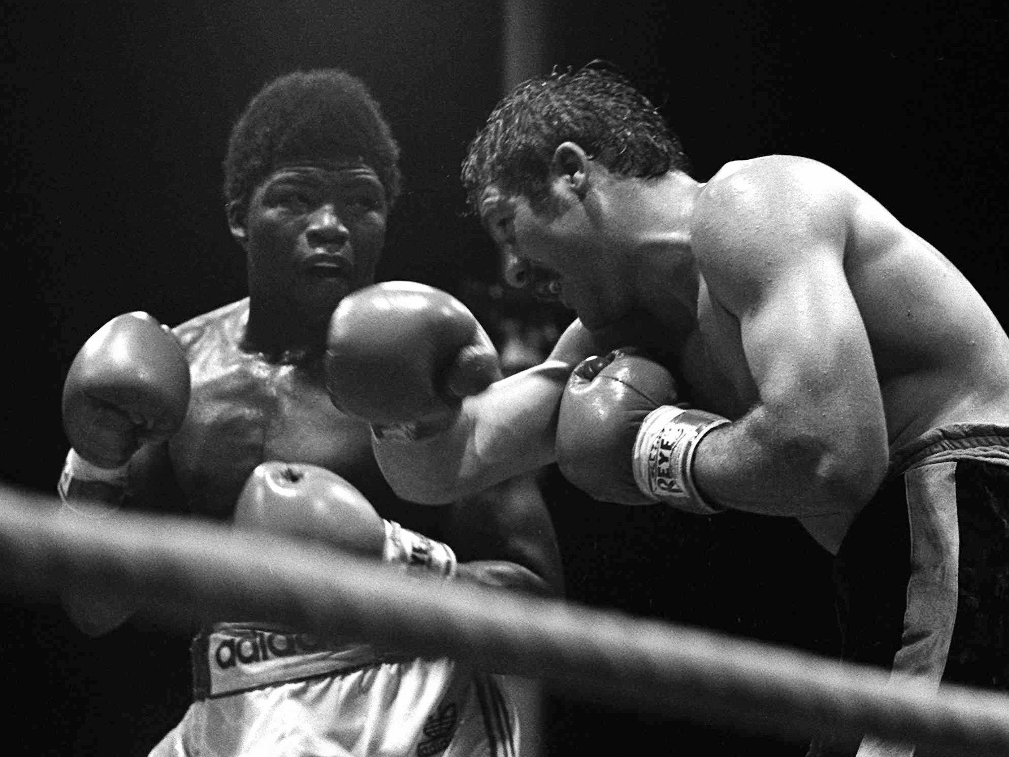 John Tate, right, from Knoxville, Tenn., exchanges blows with South Africa's Gerrie Coetzee during their world heavyweight title bout at the Loftus Versfeld stadium in Pretoria, South Africa, in this Oct. 20, 1979 file photo. Tate, 43,  was killed Thursday, April 9, 1998, when the pickup truck he was driving crashed into a utility pole. The accident occurred less than a mile from the old Ivy Glenn training camp Tate used when he won the WBA title in a decision over a battered Coetzee.(AP Photo)
