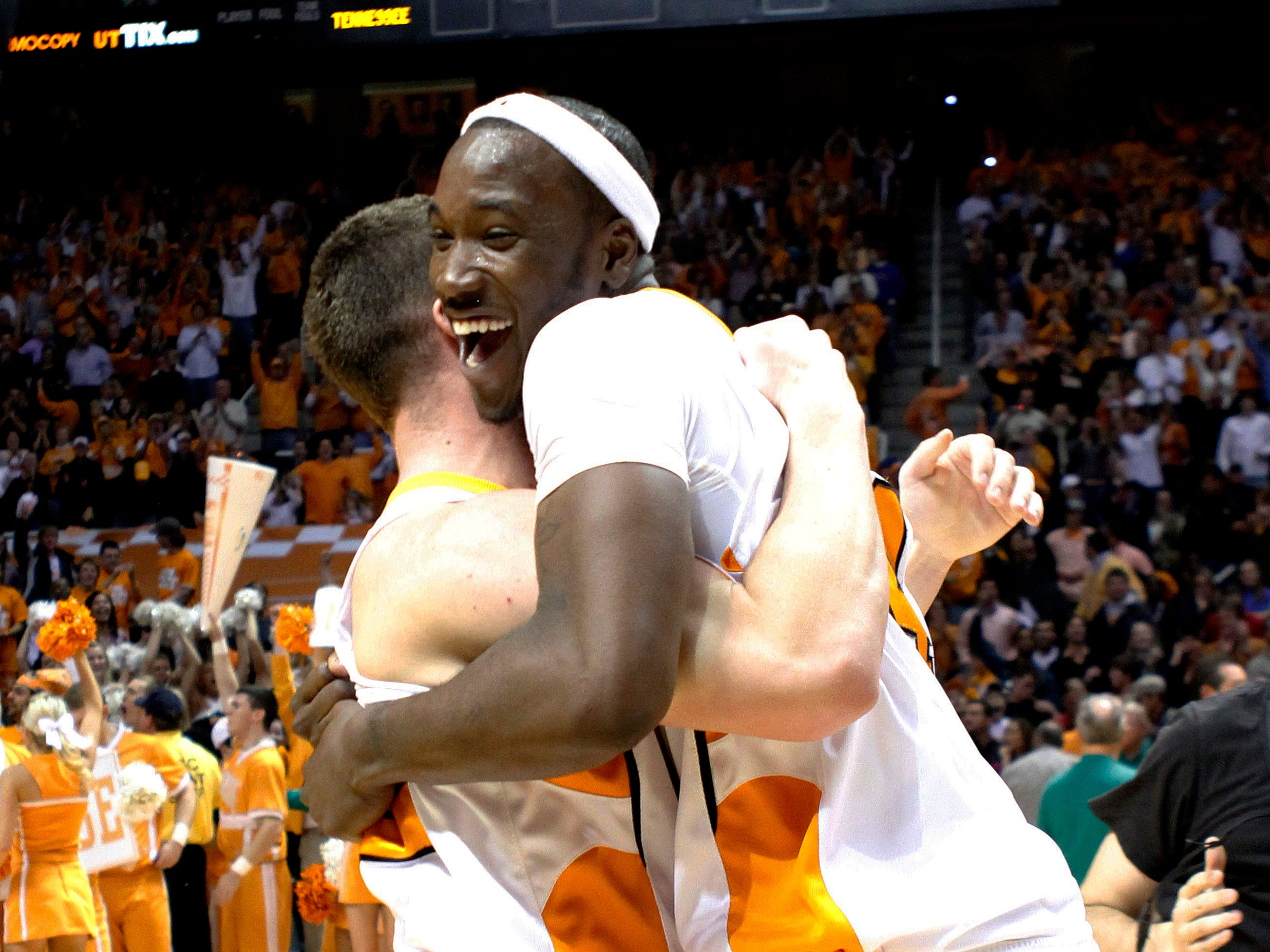 Tennessee's Wayne Chism, right, celebrates Tennessee's 76-68 victory over Kansas with teammate Stephen Pearl after their NCAA college basketball game Sunday, Jan. 10, 2010, in Knoxville, Tenn.