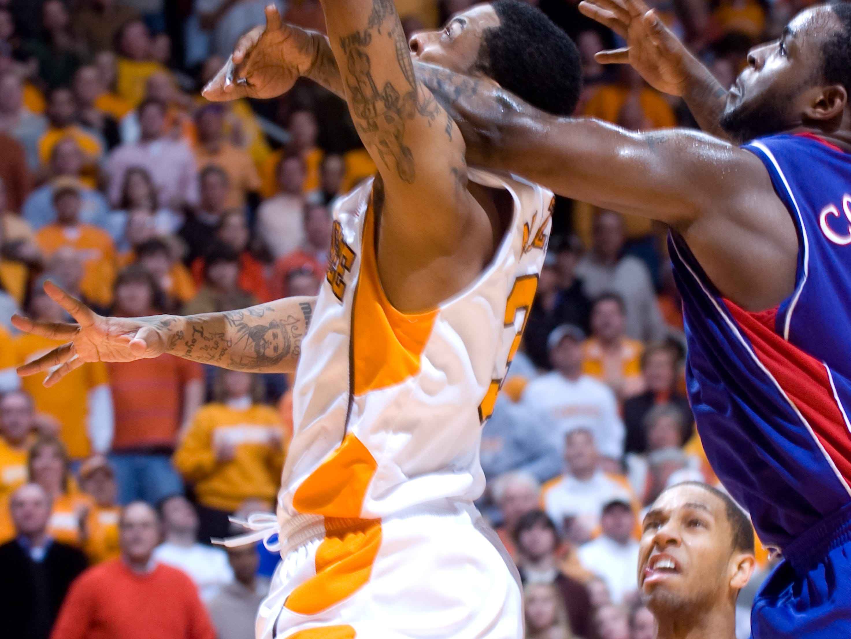 Bobby Maze is fouled by Kansas' Sheron Collins. Tennessee upsets number one ranked  Kansas 76-68 at Thompson-Boling Arena  Sunday, Jan 10, 2010.