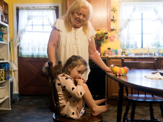 "Donna Brown tries to encourage her 3-year-old granddaughter, Hope, to be less shy for visitors. Hope, who was quiet at first, was soon speaking to everyone in the room. ""She is pretty energetic,"" said Donna, but ""there's more blessings than there are challenges."""