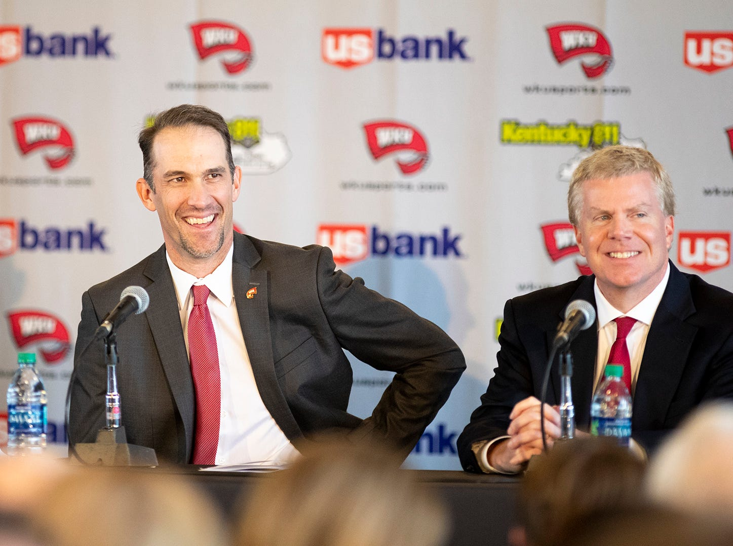 "WKU's new head coach Tyson Helton shares a smile with WKU athletic director Todd Stewart during coach Helton's press conference as the new head coach of the Hilltoppers at the Harbaugh Club in Houchens-Smith Stadium Nov. 27 in Bowling Green. ""It's not about making championships,"" said Helton. ""Its about making champions."" Helton comes to WKU after working for Tennessee and Southern California."