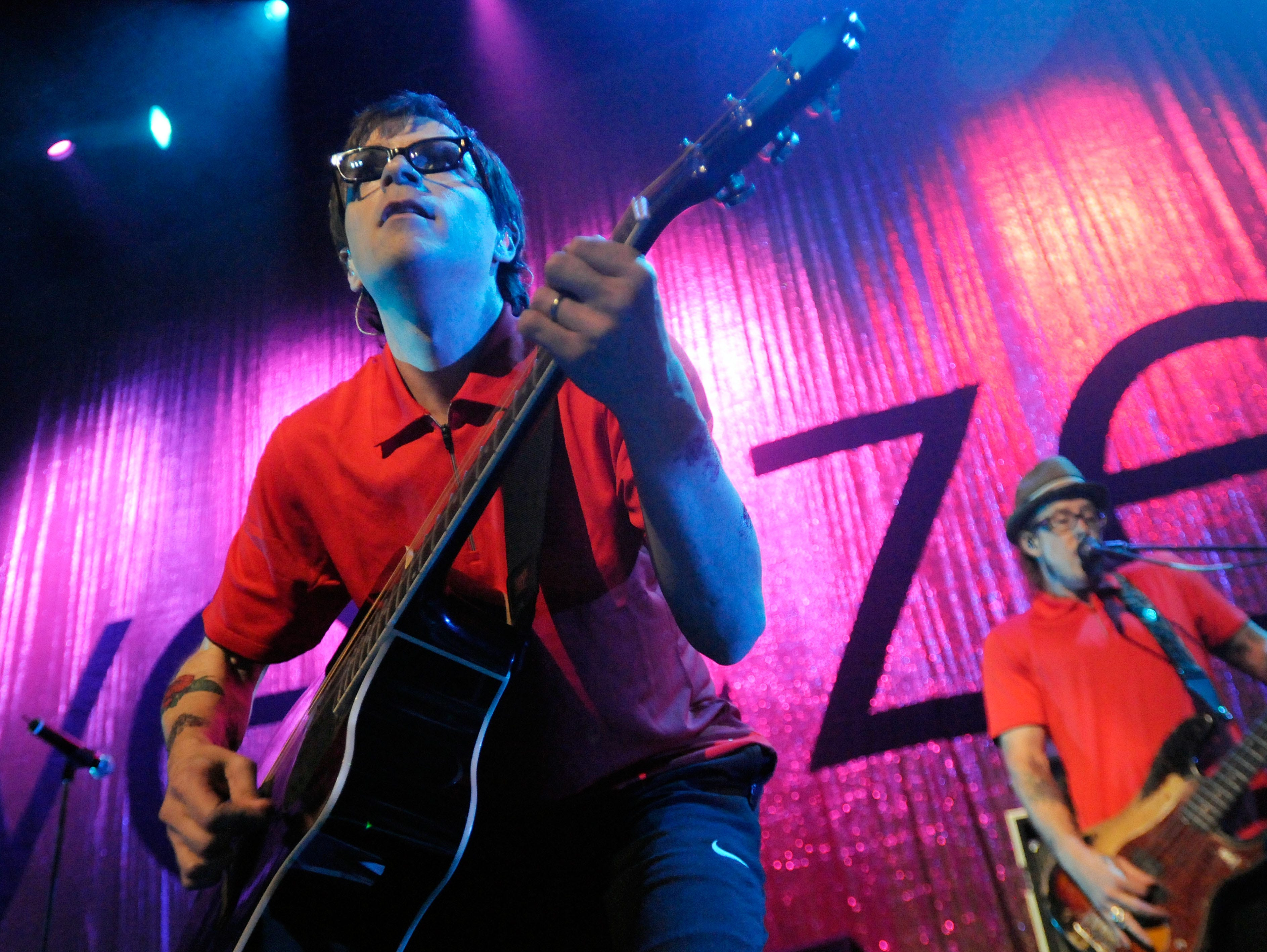 Rivers Cuomo, left, and Scott Shriner, right, of Weezer perform during the Virgin Mobile Freefest concert Sunday, Aug. 30, 2009 at Merriweather Post Pavilion in Columbia, Md. Weezer, featuring Knoxville's own Brian Bell on guitar, is scheduled to perform during the 2010 Bonnaroo Music and Arts Festival, June 10-13, in Manchester, Tenn.