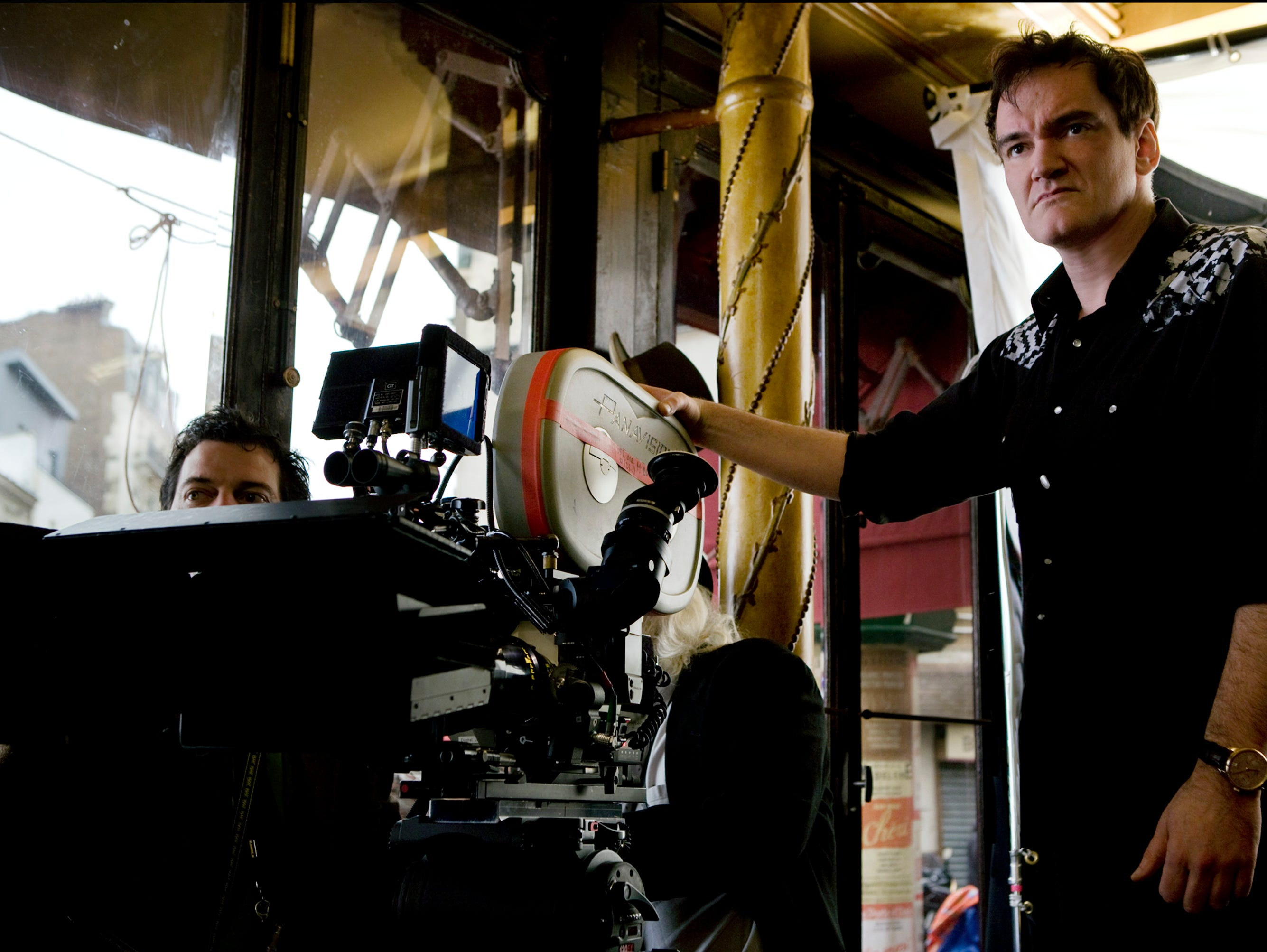 "In this film image released by The Weinstein Co., director Quentin Tarantino is shown on the set of, ""Inglourious Basterds."" The film was nominated for eight Academy Awards."