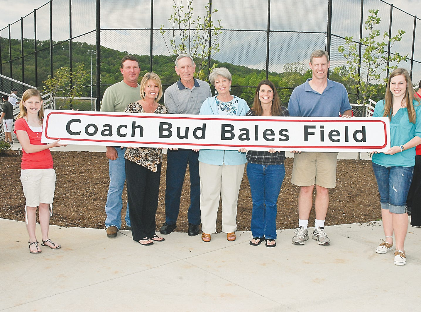 "Celebrating the naming of the Central High baseball field (in 2010) after former coach Walter ""Bud"" Bales are Alyssa Bales (granddaughter), son-in-law and daughter Mike and Lori Snapp, Bud and Carol Bales, daughter-in-law and son Pam and Rusty Bales and granddaughter Chelsea Bales. Not pictured are nephew Tim Reeves and great-nieces Alicia and Natalie Reeves."