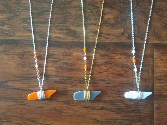 Nothing Too Fancy is selling glass Tennessee necklaces.