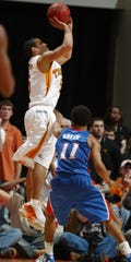 UTMENSBBCC#4591.JPG-----sports----Tennessee's Chris Lofton fires up a three-pointer against Florida Saturday at Thompson-Boling Arena. Tennessee upset No. 2 Florida 80-76 as Lofton scored 29 points. 
