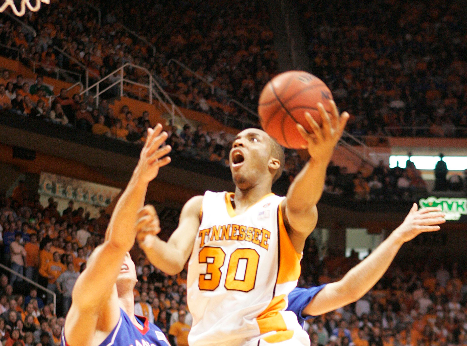Tennessee's J.P. Prince (30) drives to the basket against Kansas'  Cole Aldrich (45) during the first half of an NCAA college basketball game Sunday, Jan. 10, 2010 in Knoxville, Tenn.