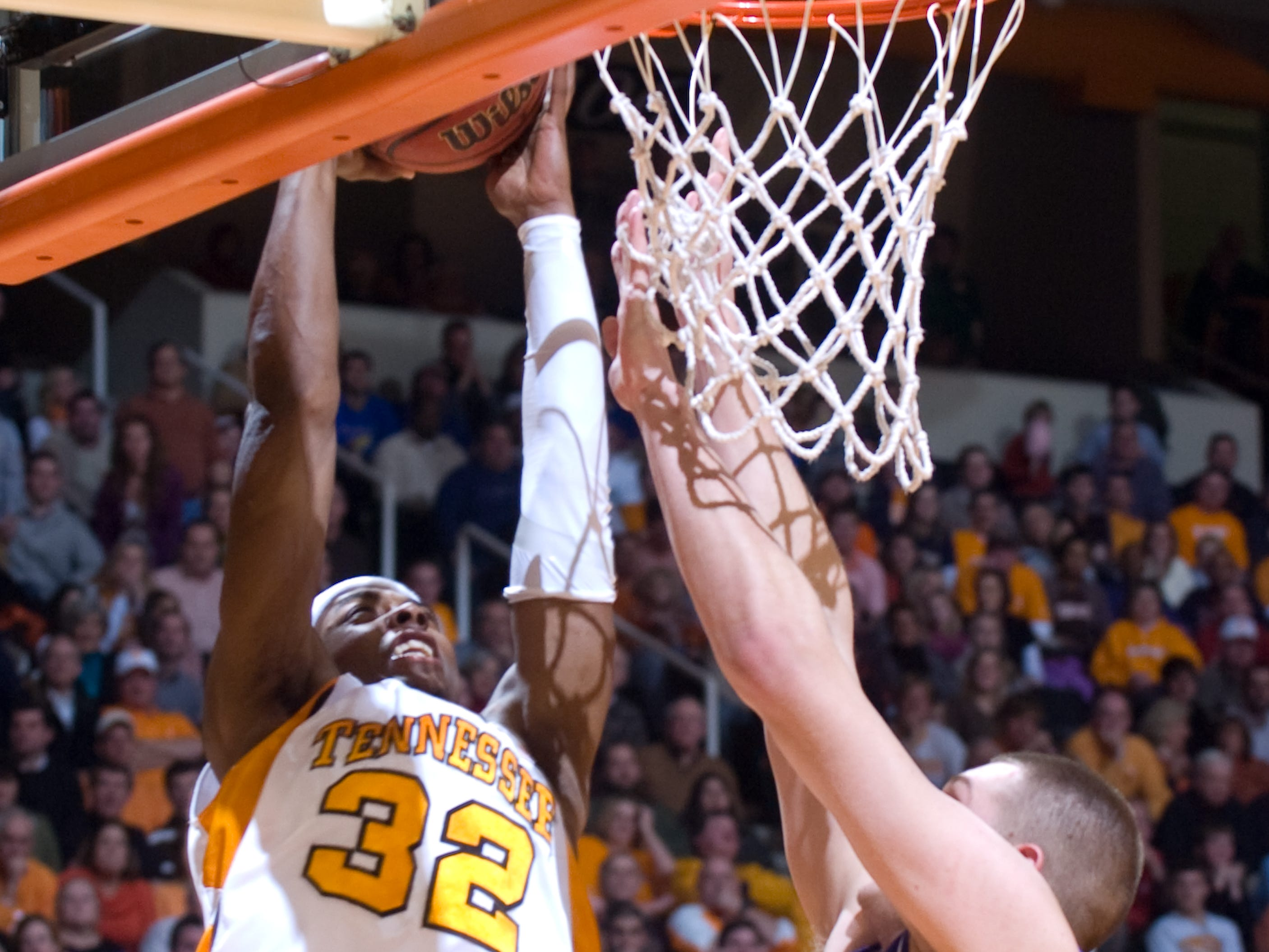 Scotty Hopson goes in for a dunk over Kansas' Cole Aldrich. Hopson had 17 points and 4 rebounds. Tennessee upsets number one ranked  Kansas 76-68 at Thompson-Boling Arena  Sunday, Jan 10, 2010.