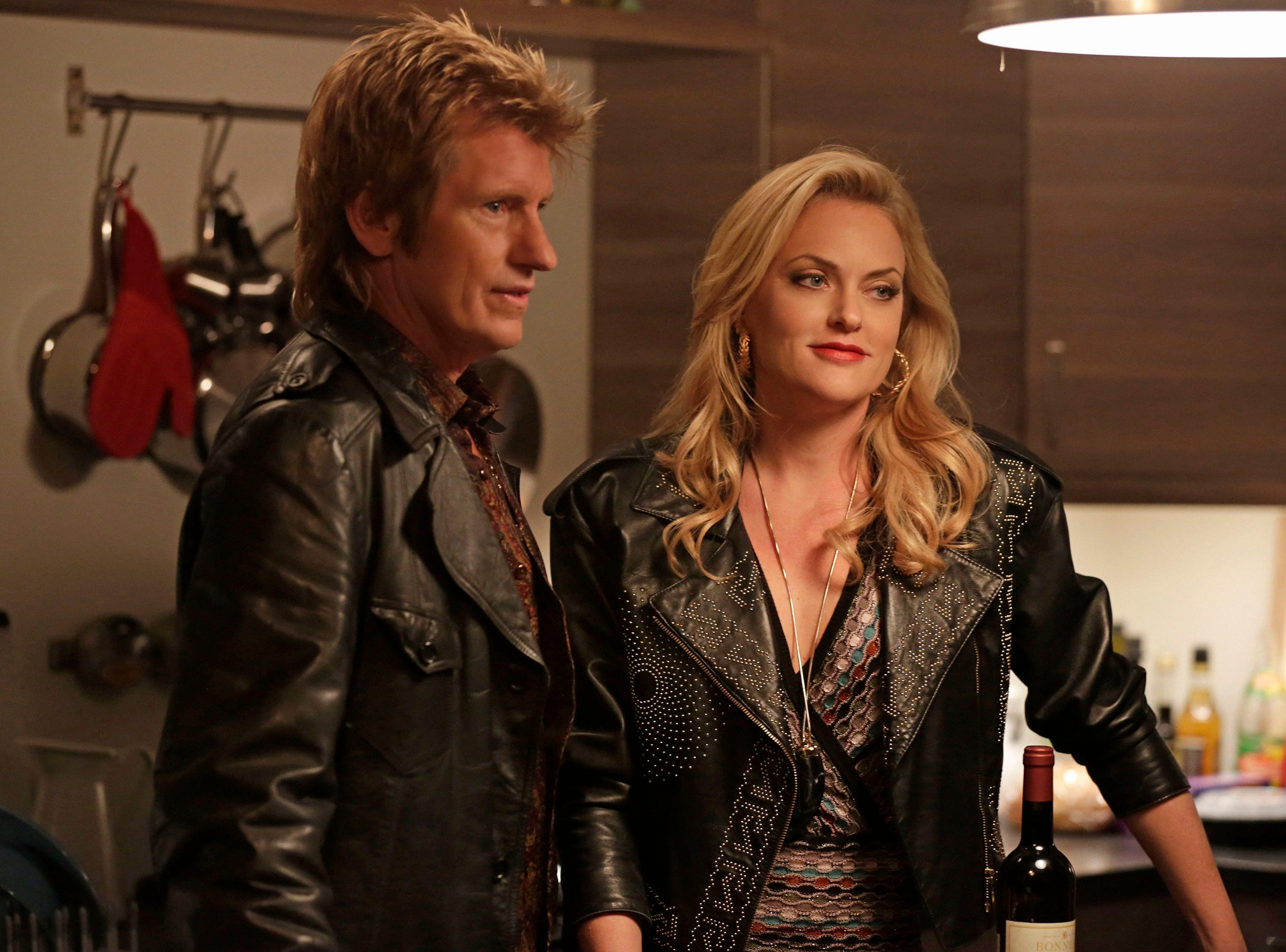 Pictured: (l-r) Denis Leary as Johnny Rock, Elaine Hendrix as Ava.