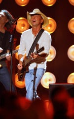 Kenny Chesney performs at the American Country Countdown Awards at the Music City Center on Monday, Dec. 15, 2014, in Nashville, Tenn.