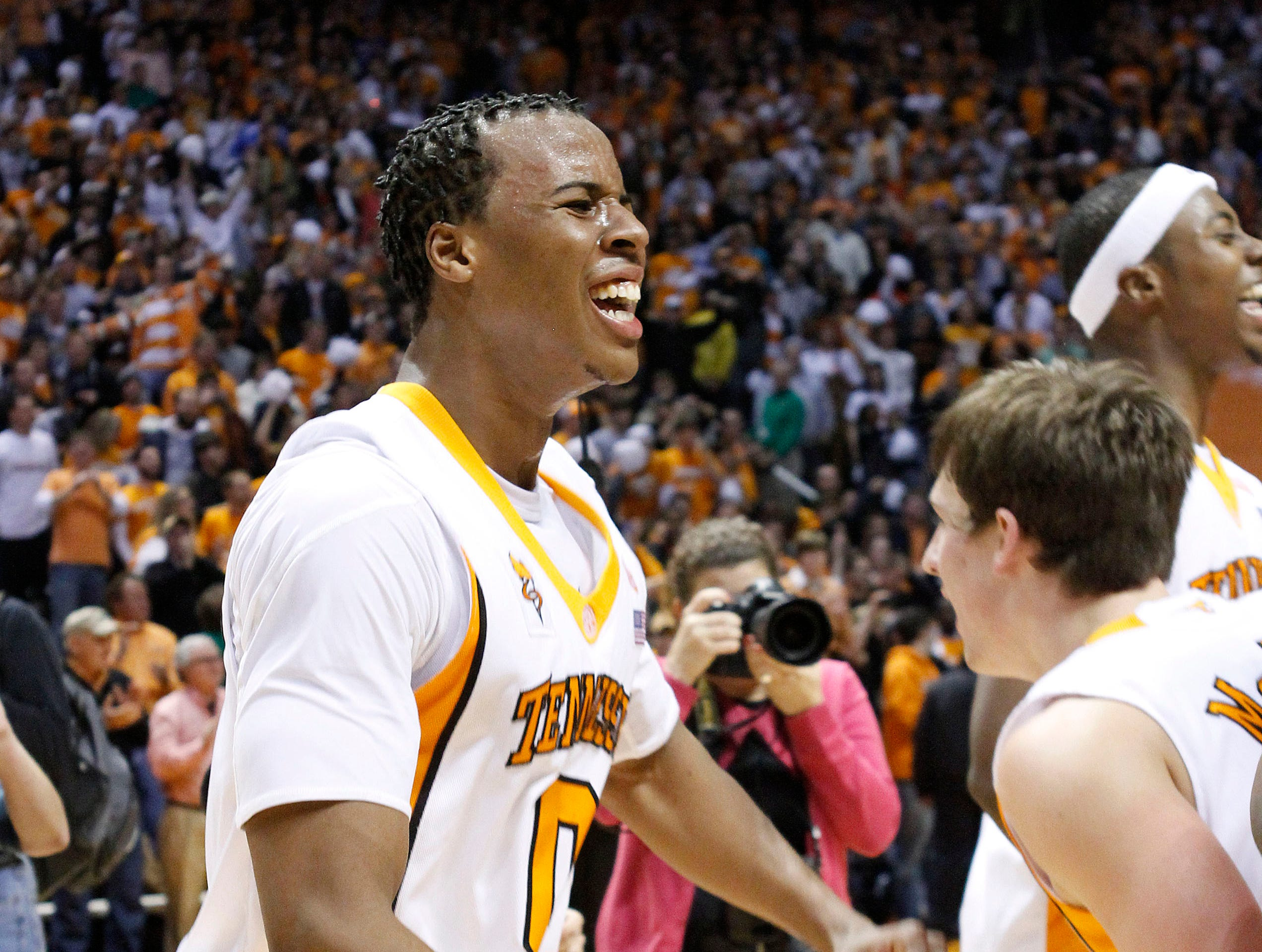 Tennessee's Renaldo Woolridge (0) and teammates celebrate after Tennessee's 76-68 win over Kansas in an NCAA college basketball game Sunday, Jan. 10, 2010, in Knoxville, Tenn.