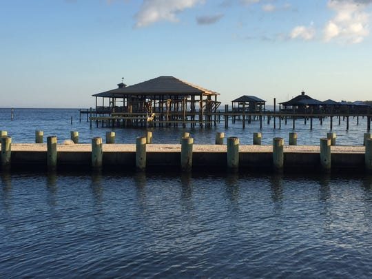 An evening walk by the boathouses on Mobile Bay can provide a tranquil end to an activity-filled day at the Grand Hotel Golf Resort and Spa in Point Clear, Ala.