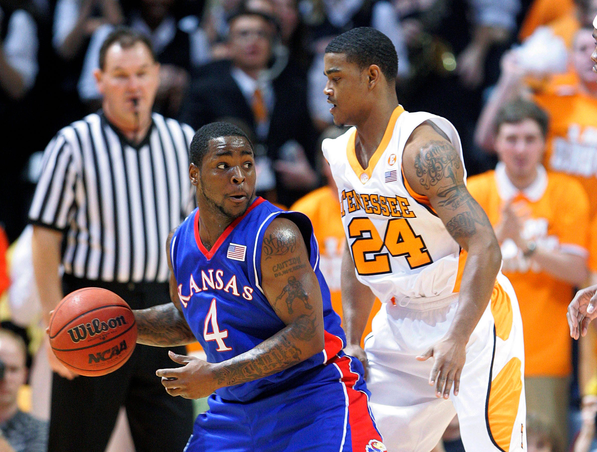 Kansas' Sherron Collins (4) drives against Tennessee's Josh Bone (24) during the first half of an NCAA college basketball game Sunday, Jan. 10, 2010, in Knoxville, Tenn. Tennessee won 76-68.