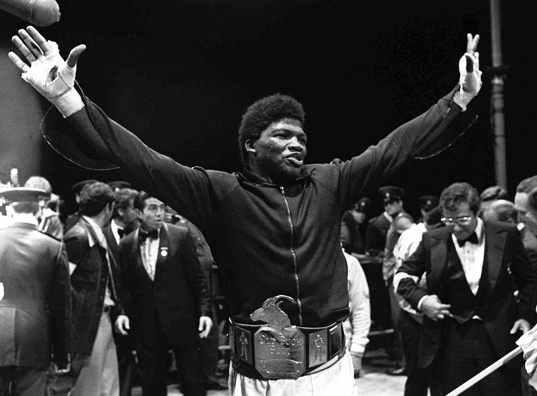 John Tate, from Knoxville, Tenn., holds his arms up in triumph after beating South Africa's Gerrie Coetzee on points for the world heavywight title at the Loftus Versfeld stadim in Pretoria, South Africa, in this Oct. 20, 1979 file photo. Tate, 43,  was killed Thursday, April 9, 1998, when the pickup truck he was driving crashed into a utility pole. The accident occurred less than a mile from the old Ivy Glenn training camp Tate used after he won the WBA title over a battered Coetzee.