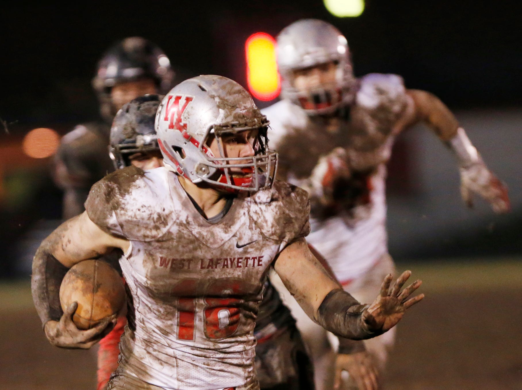 Sage Hood with a second half carry against Ft. Wayne Bishop Luers Friday, November 16, 2018, in Ft. Wayne. West Lafayette scored 27 unanswered points in the second half to come from behind and defeat Bishop Luers 27-14.