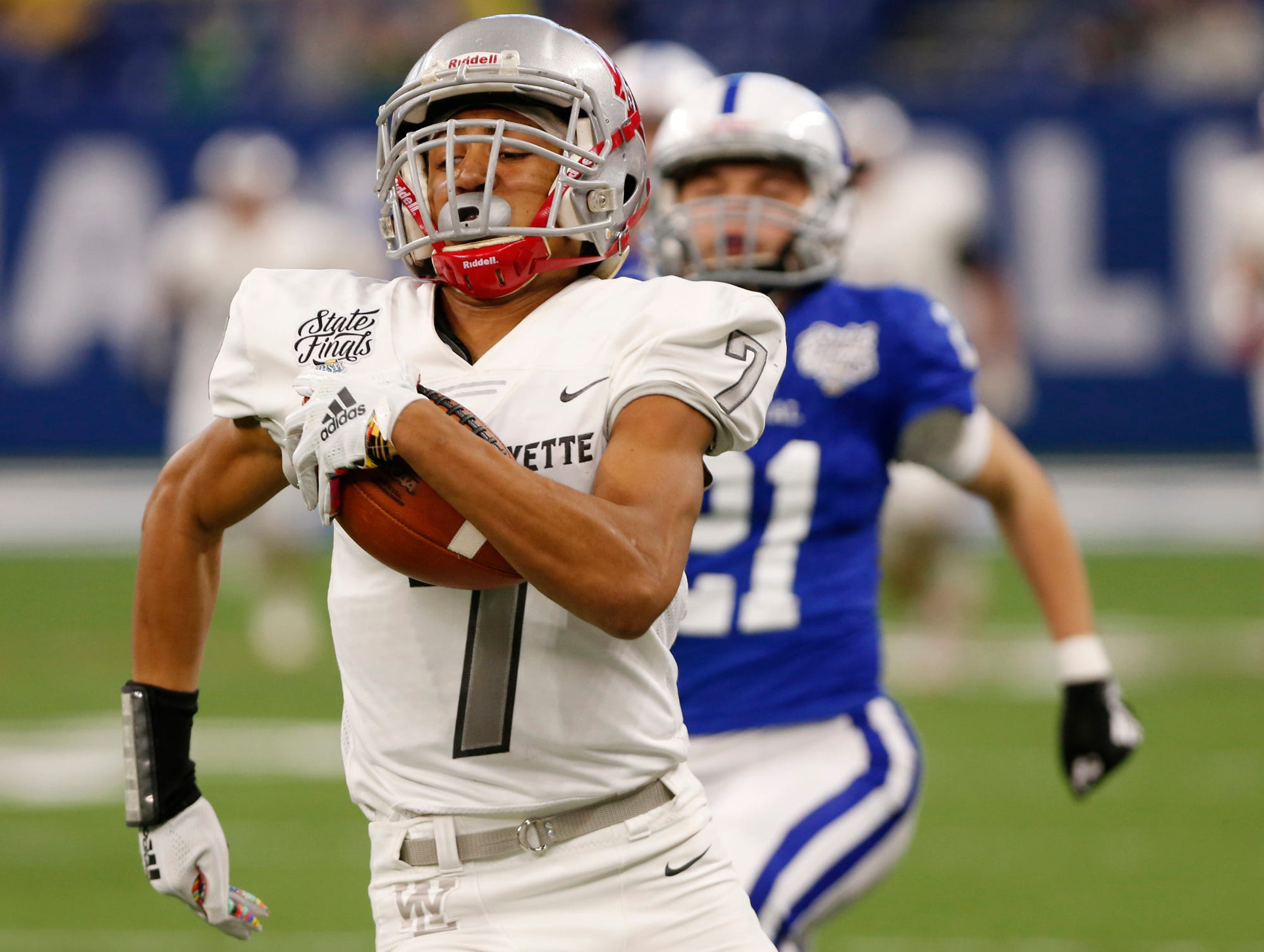 Kyle Hazell races to the end zone on a touchdown reception at 9:11 in the first quarter against Evansville Memorial in the Class 3A State Championship Saturday, November 24, 2018, at Lucas Oil Stadium in Indianapolis. West Lafayette defeated Evansville Memorial 47-42 to claim the Class 3A state title.