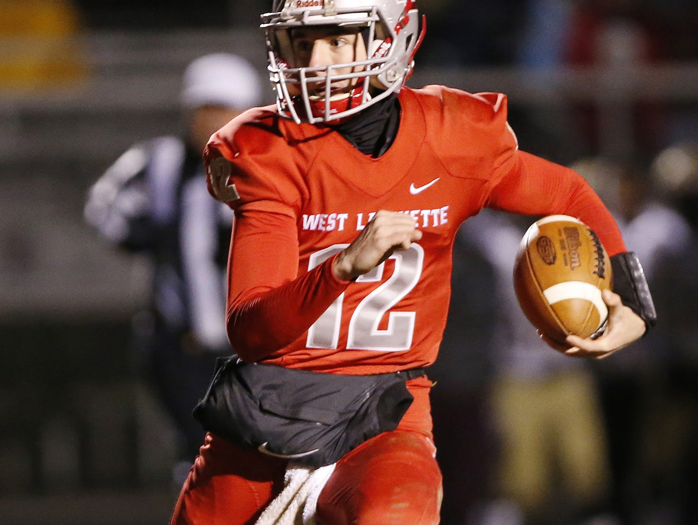 West Lafayette quarterback Kyle Adams with a carry against Brebeuf in the football regional Friday, November 9, 2018, at Gordon Straley Field in West Lafayette. West Lafayette defeated Brebeuf 24-10.