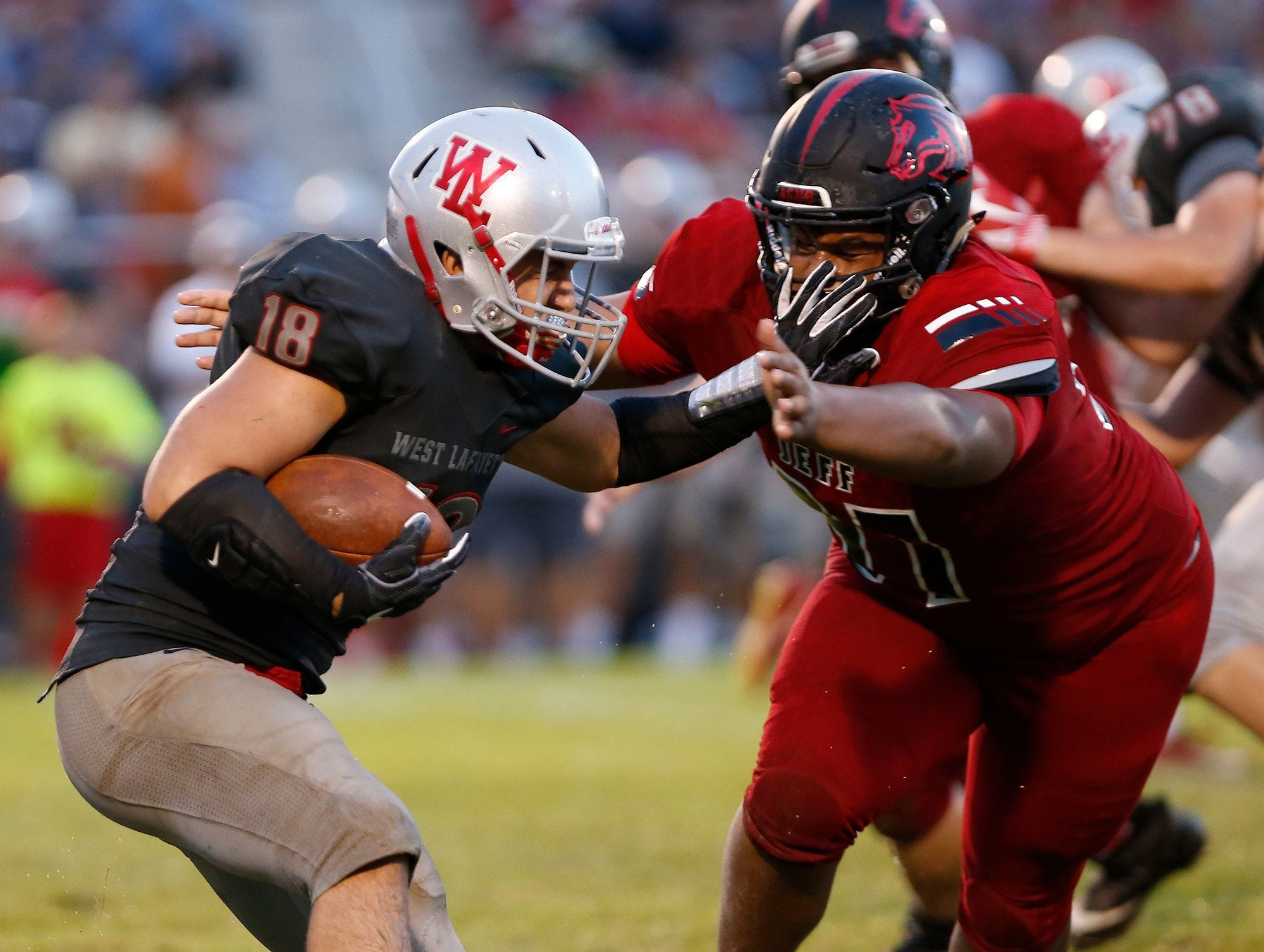 Sage Hood of West Lafayette is wrapped up by Peyton Price of Lafayette Jeff on Friday at Gordon Straley Field in West Lafayette. West Lafayette defeated Jeff 38-29.