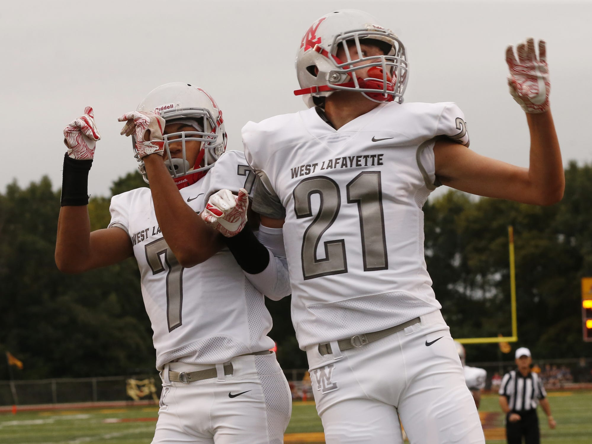 Harrison Truitt of West Lafayette celebrates with teammate Kyle Hazell after his touchdown reception at 7:35 in the first quarter against McCutcheon Friday, August 24, 2018, in Lafayette. West Lafayette defeated McCutcheon 34-20.