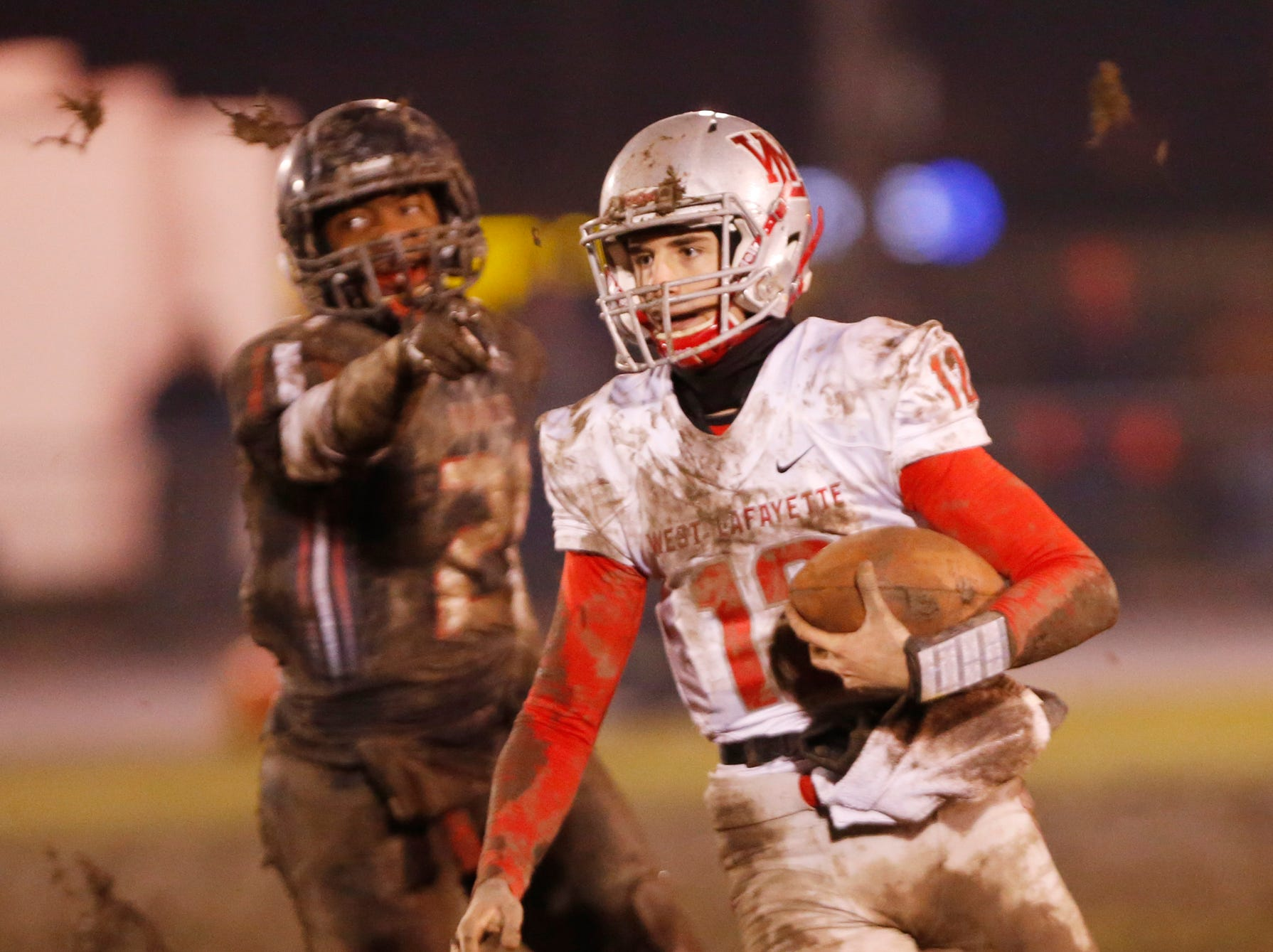 West Lafayette quarterback Kyle Adams with a fourth quarter carry against Ft. Wayne Bishop Luers Friday, November 16, 2018, in Ft. Wayne. West Lafayette scored 27 unanswered points in the second half to come from behind and defeat Bishop Luers 27-14.