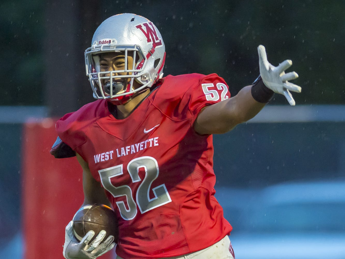 Tavion Woodard scoops a Knight fumble and scores in the  West Lafayette vs. Central Catholic game on a very wet and muddy Gordon Starlet Field.  Red Devils defeated the Knights 34-0.