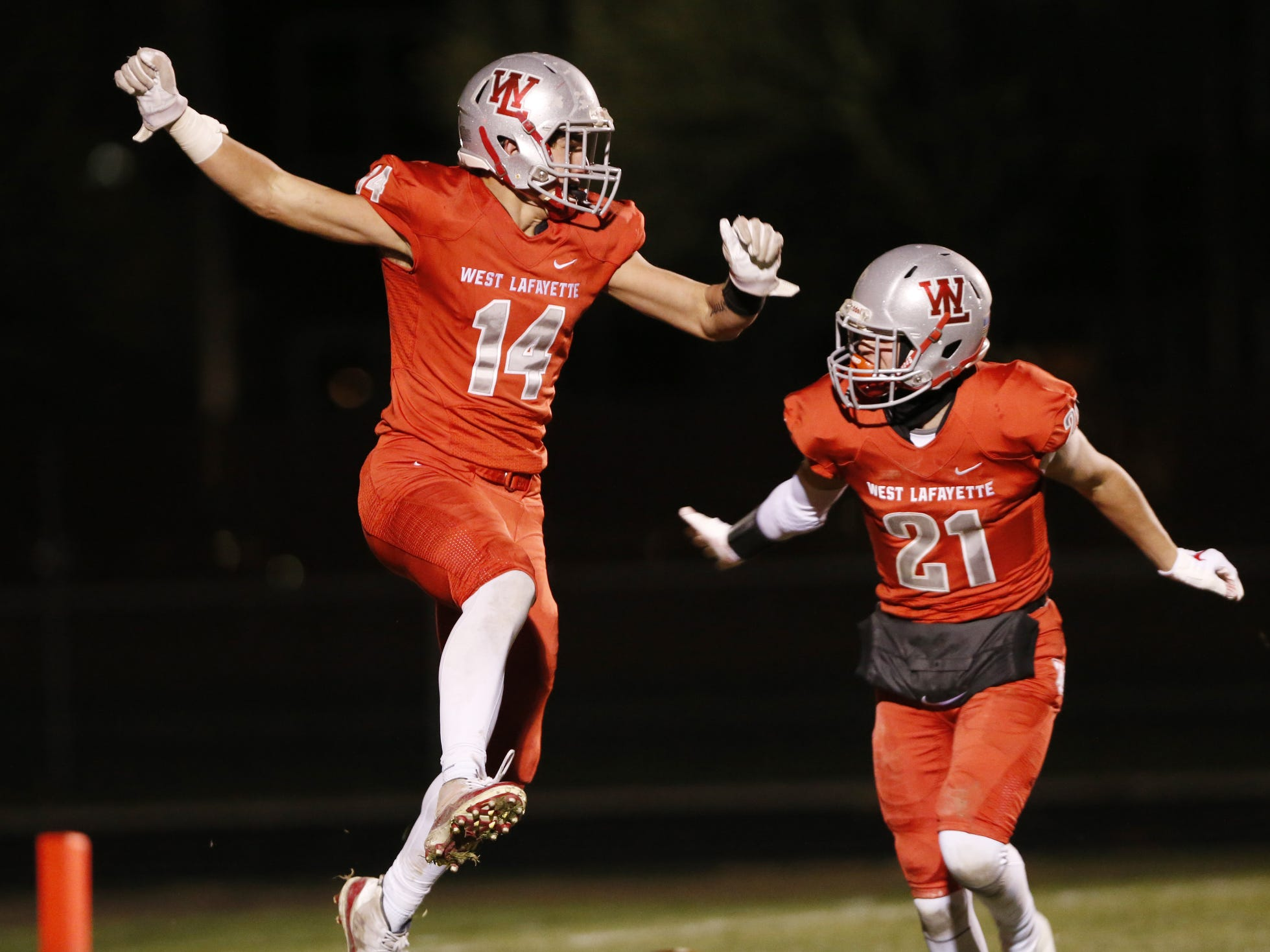 Yanni Karlaftis, left, of West Lafayette celebrates with teammate Harrison Truitt after his touchdown reception at 4:54 in the third quarter against Brebeuf in the football regional Friday, November 9, 2018, at Gordon Straley Field in West Lafayette. West Lafayette defeated Brebeuf 24-10.