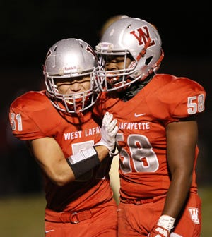 Lamont Johnson, right, and HoJun Yun have a combined 130 tackles, including 20 for loss, through eight games this season.