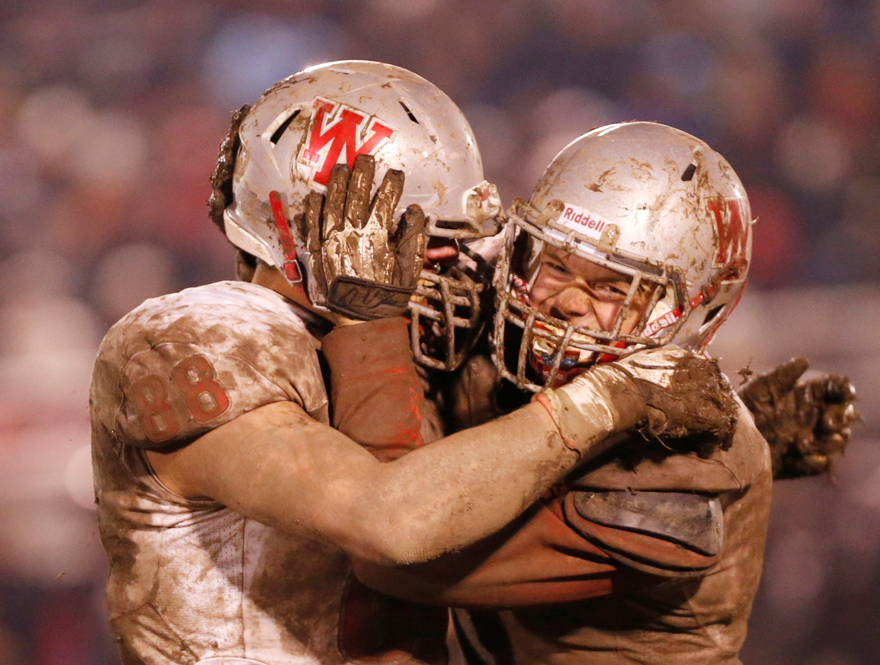 George Karlaftis, left, and Ben Szymanski of West Lafayette celebrate after Ft. Wayne Bishop Luers turns the ball over on downs Friday, November 16, 2018, in Ft. Wayne. West Lafayette scored 27 unanswered points in the second half to come from behind and defeat Bishop Luers 27-14.