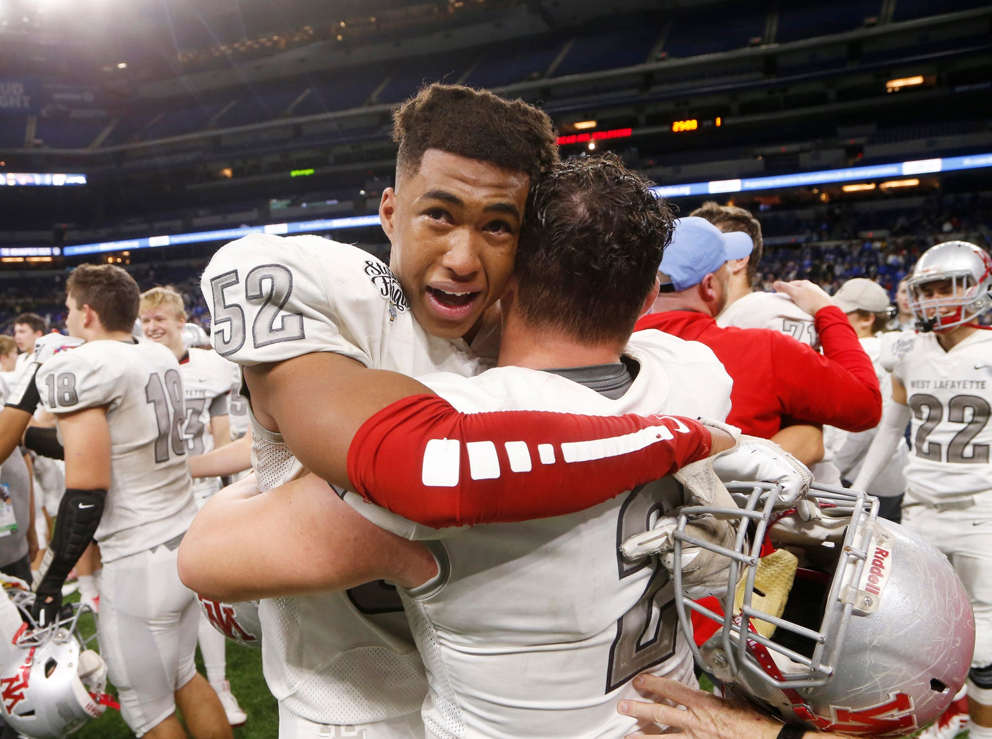 Tavion Woodard of West Lafayette celebrates with teammate Joey Kidwell after the Red Devils defeated Evansville Memorial 47-42 in the Class 3A State Championship Saturday, November 24, 2018, at Lucas Oil Stadium in Indianapolis.