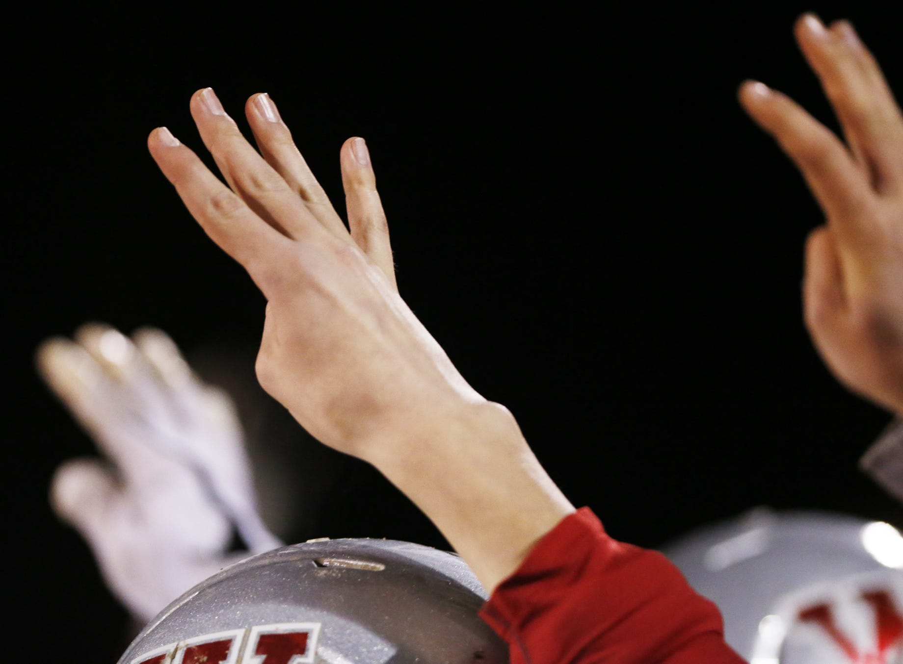 West Lafayette players raise their hands with four fingers as they head into the fourth quarter against Brebeuf in the football regional Friday, November 9, 2018, at Gordon Straley Field in West Lafayette. West Lafayette defeated Brebeuf 24-10.