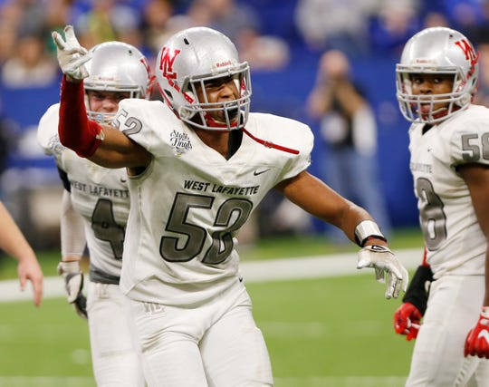 Tavion Woodard of West Lafaytte celebrates after tackling Evansville Memorial quarterback Michael Lindauer in the fourth quarter in the Class 3A State Championship Saturday, November 24, 2018, at Lucas Oil Stadium in Indianapolis. West Lafayette defeated Evansville Memorial 47-42 to claim the Class 3A state title.