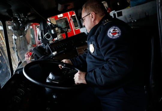 Lancaster Fire Capt. Brian Archer tries to shift a 1994 mini tower truck Tuesday, Nov. 27, 2018, at Engine House 1 in downtown Lancaster form park to drive. The truck is currently the department's only reserve engine. When firefighters tried to drive the truck out of the station for a photograph Tuesday they discovered they couldn't shift it out of park. Monday night the department asked city council to approve the purchase of a new fire engine that would rotate with the city's other fire trucks to decrease wear on all the equipment.