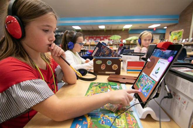 7-year-old Hannah Jellison develops her technical and critical thinking skills playing Osmo Detective Agency at Hornung Elementary's Maker Space unit in the media center Tuesday, Nov. 27, 2018.