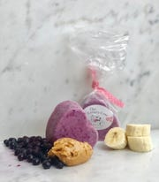 Comfy Cow makes Pooch Pops, homemade frozen treats for your four-legged friends made from plain yogurt, peanut butter, blueberries, bananas and vanilla extract.