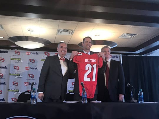 New Western Kentucky University football coach Tyson Helton (center) smiles with school president Tim Caboni (left) and athletic director Todd Stewart at Helton's introductory press conference. Nov. 27, 2018