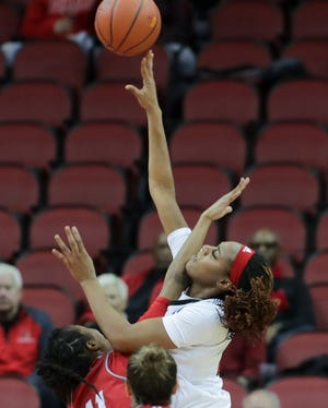 Louisville's Bionca Dunham scores and gets fouled for the and one. 