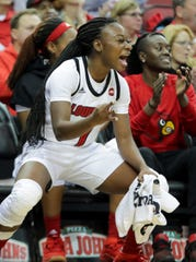 Louisville's Dana Evans celebrates on the sideline after the Cards score against the Redhawks.  Nov. 26, 2018