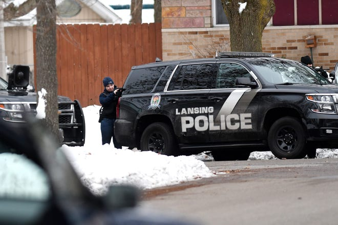 Lansing police surround a home on the 4400 block of Stillwell Avenue on Tuesday, Nov. 27, 2018, on the south side of the city.