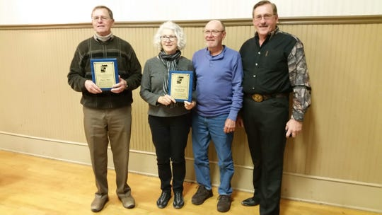 Manitowoc County Lakes Association award winners include (from left) Eugene Weyer,June and Frank Scharenbroch, and Tom Ward.