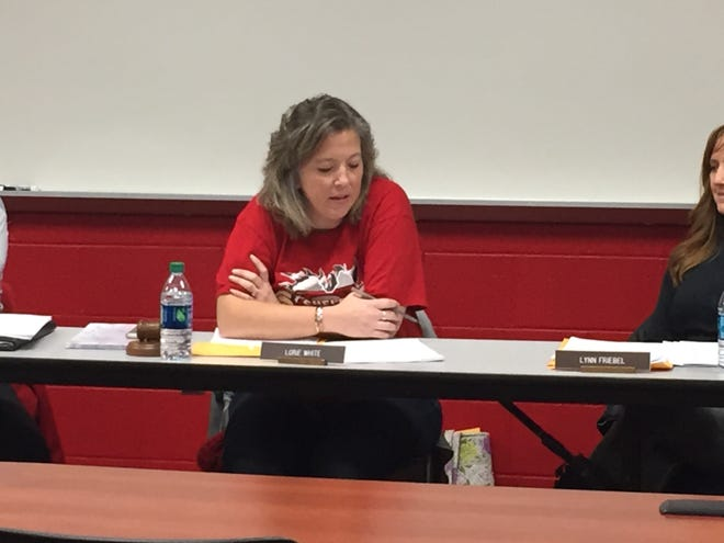 Shelby school board president Lorie White reads a prepared statement at Monday's meeting.