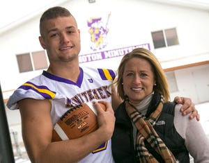 Lexington football player Cade Stover poses with his mom Chelsi Stover after learning he is the 2018 Mr. Football Award winner.