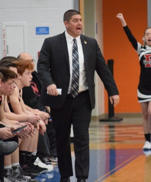 Pleasant boys basketball coach Ben Snively works the sidelines during a Division III district tournament game against Harvest Prep.