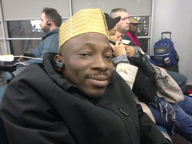 Seyi Owoyele of Memphis has had multiple canceled flights trying to return home from Chicago after a post-Thanksgiving snowstorm.